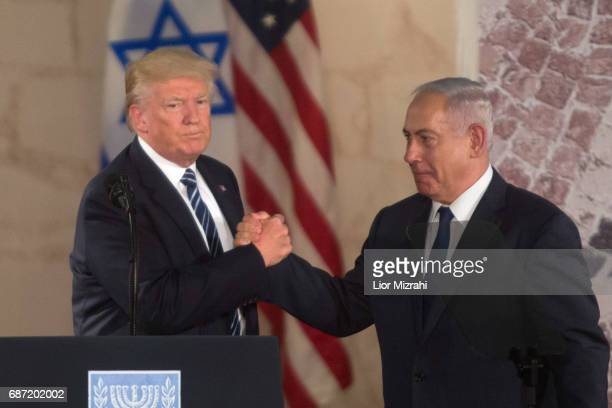 US President Donald Trump and Israel's Prime Minister Benjamin Netanyahu shake hands after delivering a speech during a visit to the Israel Museum on...