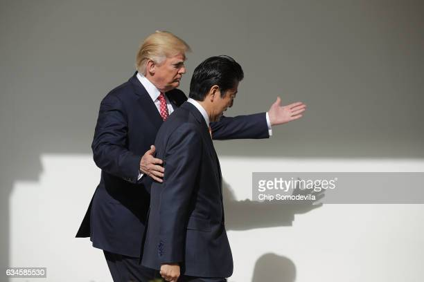 US President Donald Trump and Japan Prime Minister Shinzo Abe walk together to their joint press conference in the East Room at the White House on...