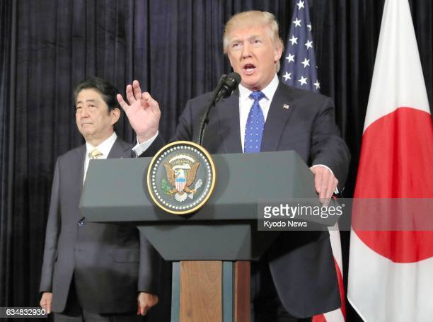 US President Donald Trump and Japanese Prime Minister Shinzo Abe attend a joint press conference in Palm Beach Florida on Feb 11 responding to the...