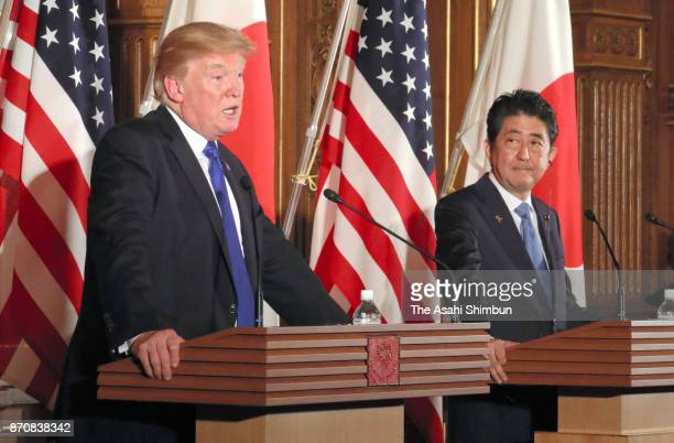 US President Donald Trump and Japanese Prime Minister Shinzo Abe attend a joint press conference following their meeting at the Akasaka State Guest...