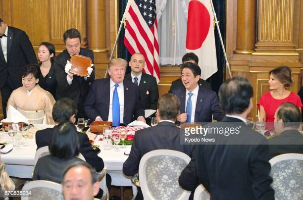 US President Donald Trump and Japanese Prime Minister Shinzo Abe chat at a dinner party at the Akasaka Palace state guesthouse in Tokyo on Nov 6 2017...