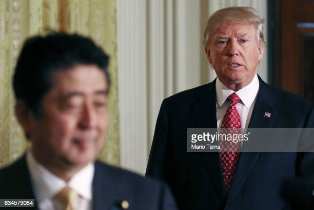 S President Donald Trump and Japanese Prime Minister Shinzo Abe enter before holding a joint press conference at the White House on February 10 2017...