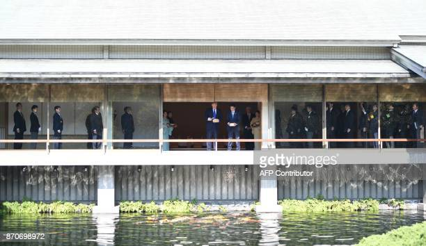President Donald Trump and Japanese Prime Minister Shinzo Abe feed koi fish during a welcoming ceremony in Tokyo on November 6 2017 Trump lashed out...
