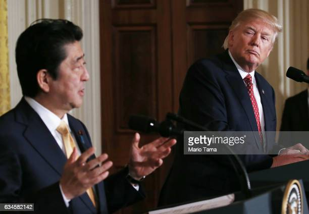 President Donald Trump and Japanese Prime Minister Shinzo Abe hold a joint press conference at the White House on February 10 2017 in Washington DC...