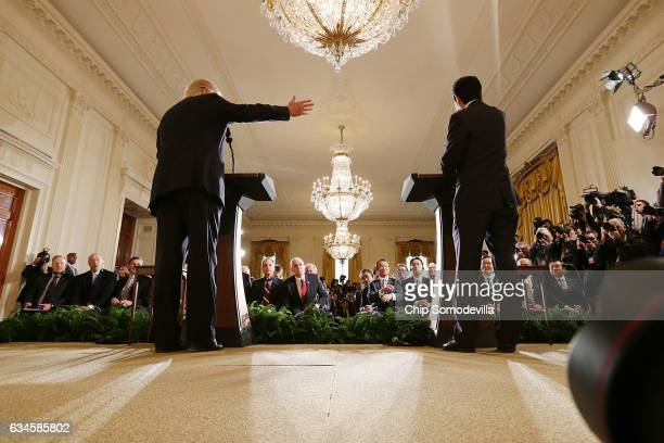 S President Donald Trump and Japanese Prime Minister Shinzo Abe hold a joint news conference in the East Room at the White House February 10 2017 in...