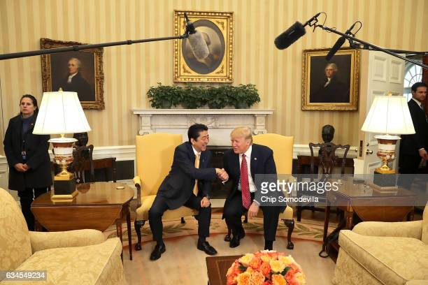 US President Donald Trump and Japanese Prime Minister Shinzo Abe pose for photographs before bilateral meetings in the Oval Office at the White House...