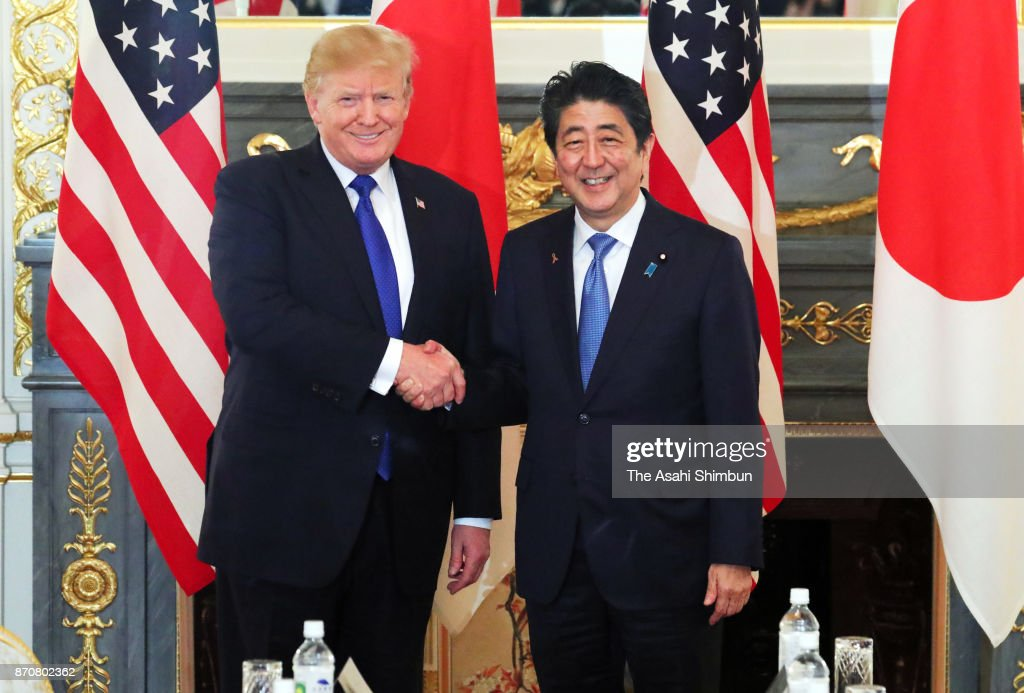 U.S. President Donald Trump (L) and Japanese Prime Minister Shinzo Abe (R) shake hands prior to their meeting at the Akasaka State Guest House on November 6, 2017 in Tokyo, Japan. Trump is on 11-day tour to Asia.