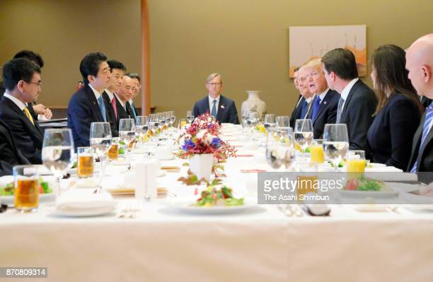 US President Donald Trump and Japanese Prime Minister Shinzo Abe talk during their working lunch at the Akasaka State Guest House on November 6 2017...