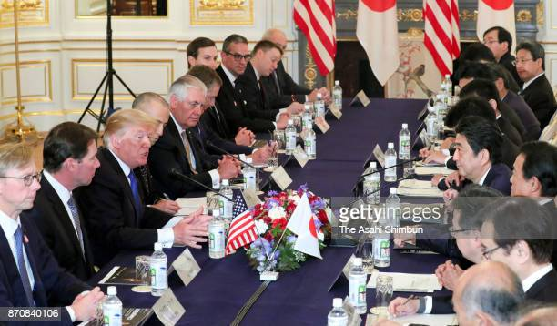 US President Donald Trump and Japanese Prime Minister Shinzo Abe talk during their meeting at the Akasaka State Guest House on November 6 2017 in...