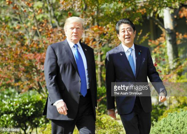 US President Donald Trump and Japanese Prime Minister Shinzo Abe walk the garden prior to their working lunch at the Akasaka State Guest House on...
