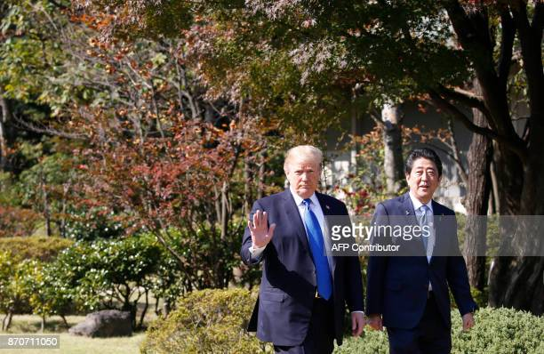 US President Donald Trump and Japan's Prime Minister Shinzo Abe walk before their working lunch at Akasaka Palace in Tokyo on November 6 2017 Trump...