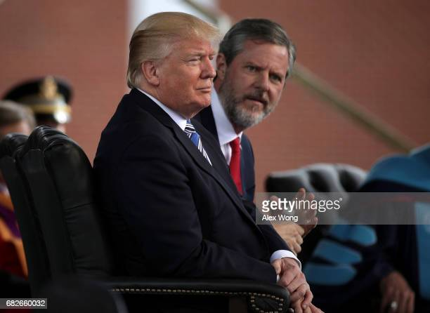 S President Donald Trump and Jerry Falwell President of Liberty University on stage during a commencement at Liberty University May 13 2017 in...