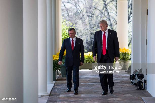 President Donald Trump and Jordan's King Abdullah II walk through the colonnade before holding a news conference in the Rose Garden of the White...