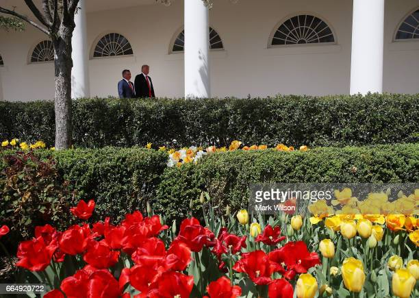 S President Donald Trump and King Abdullah II of Jordan walk along the colonade after a news conference in the Rose Garden at the White House April 5...