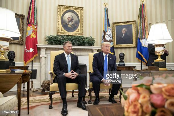 US President Donald Trump and Klaus Iohannis Romania's president right sit during a meeting at the Oval Office of the White House in Washington DC US...