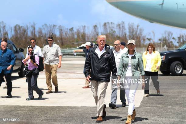 President Donald Trump and Melania Trump arrive on Air Force One at the Muniz Air National Guard Base for a visit after Hurricane Maria hit the...