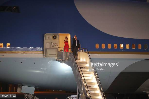 President Donald Trump and Melania Trump wave as they prepare to leave on Air Force One after holding a campaign rally at the AeroMod International...
