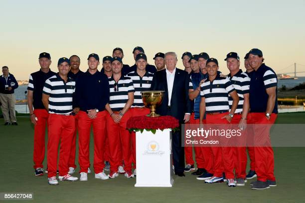 President Donald Trump and members of the US Team pose with the trophy after the US Team defeated the International Team 19 to 11 in the Presidents...