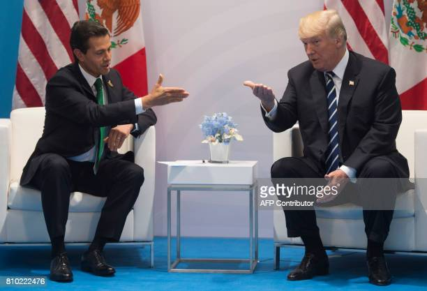 US President Donald Trump and Mexican President Enrique Pena Nieto hold a meeting on the sidelines of the G20 Summit in Hamburg Germany on July 7...
