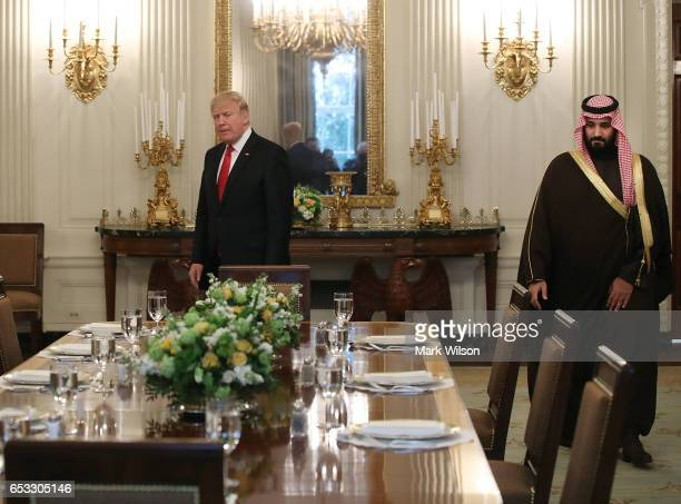 S President Donald Trump and Mohammed bin Salman Deputy Crown Prince and Minister of Defense of the Kingdom of Saudi Arabia walk into the State...