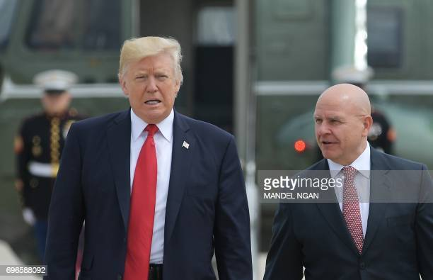 US President Donald Trump and National Security Advisor H R McMaster board Air Force One before departing from Andrews Air Force Base for Miami...