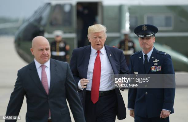 US President Donald Trump and National Security Advisor HR McMaster board Air Force One before departing from Andrews Air Force Base for Miami...