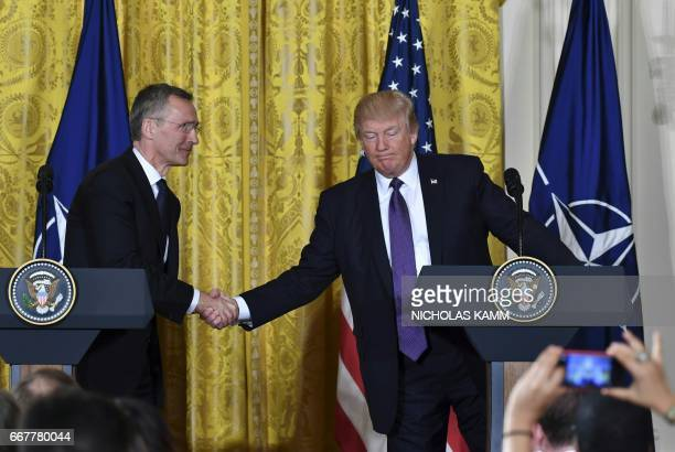 US President Donald Trump and NATO Secretary General Jens Stoltenberg shake hands during a joint press conference in the East Room at the White House...