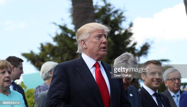 S President Donald Trump and other leaders arrive for the group photo for the G7 Outreach Program on the second and last day of the G7 Taormina...