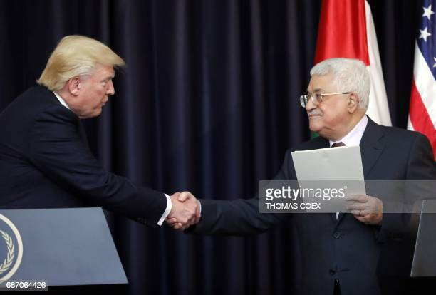 President Donald Trump and Palestinian leader Mahmud Abbas give a joint press conference at the presidential palace in the West Bank city of...