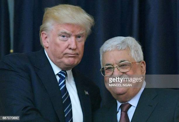 US President Donald Trump and Palestinian leader Mahmud Abbas pose for a photograph during a joint press conference at the presidential palace in the...