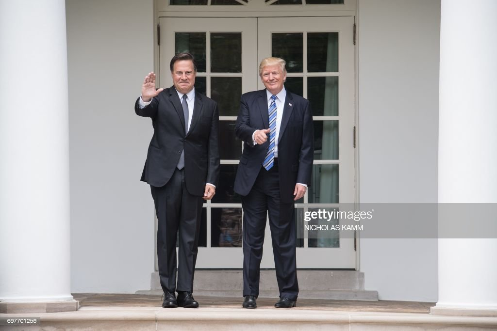 US President Donald Trump and Panamanian President Juan Carlos Varela pose for pictures in the colonnade at the White House in Washington, DC, on June 19, 2017. /