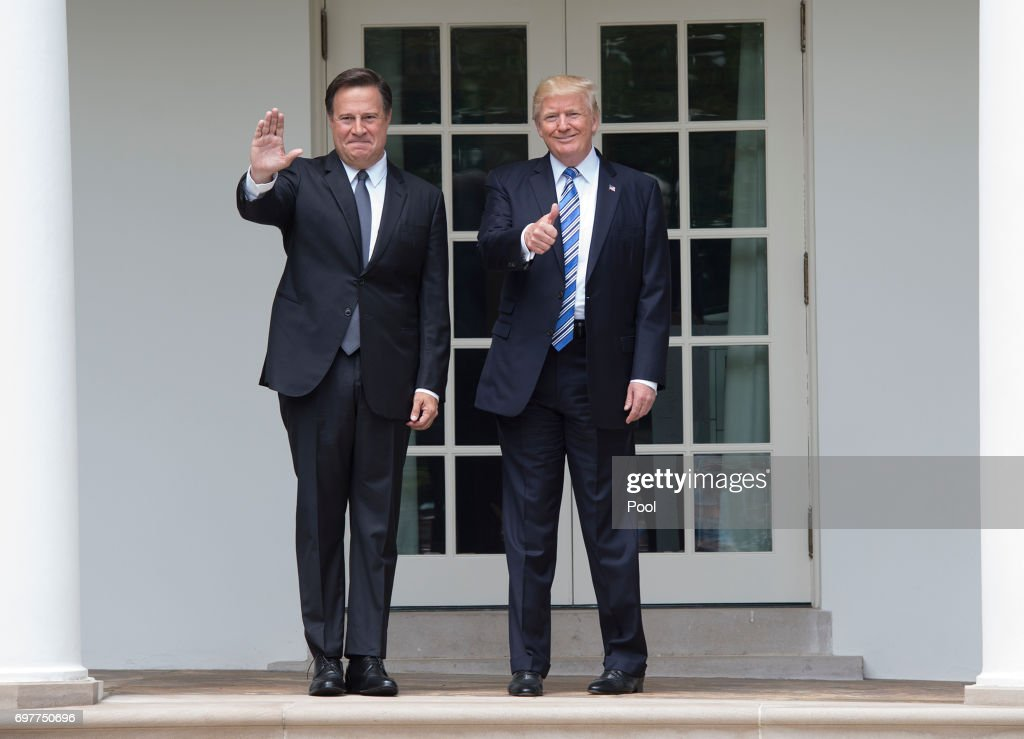 President Donald Trump and Panama's President Juan Carlos Varela greet the press outside the Oval Office at the White House on June 19, 2017 in Washington, DC. According to the White House, the two presidents will talk about how to curb 'transnational organized crime, illegal migration, and illicit substances' and the continued political and economic instability in Venezuela.