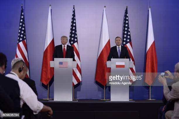 President Donald Trump and President of Poland Andrzej Duda attend a joint press conference after a meeting at the Royal Castle in Warsaw Poland on...