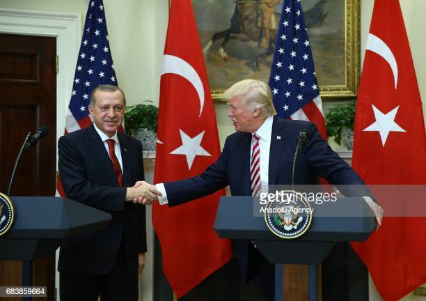 President Donald Trump and President of Turkey Recep Tayyip Erdogan shake hands after holding a joint press conference after their meeting at the...