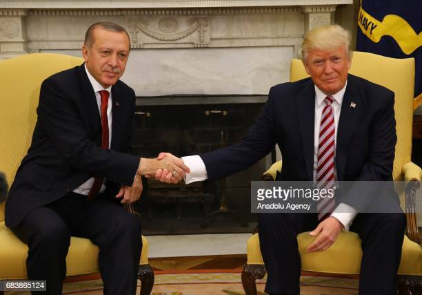 President Donald Trump and President of Turkey Recep Tayyip Erdogan shake hands during their meeting at the Oval Office of the White House in...