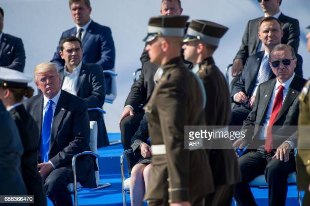 US President Donald Trump and President of Turkey Recep Tayyip Erdogan attend the handover ceremony of the new headquarters of NATO in Brussels on...