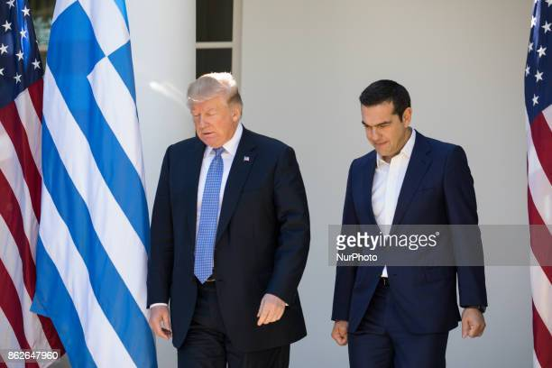 US President Donald Trump and Prime Minister Alexis Tsipras of Greece leave the Oval Office to walk to the Rose Garden of the White House for their...
