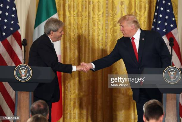 S President Donald Trump and Prime Minister Paolo Gentiloni of Italy shake hands during a news conference in the East Room at the White House on...