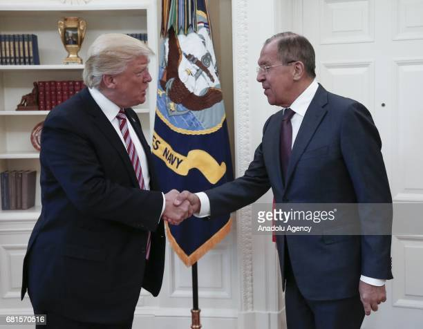 President Donald Trump and Russia's Foreign Minister Sergei Lavrov shake hands as they meet at the Oval Office of White House in Washington DC United...