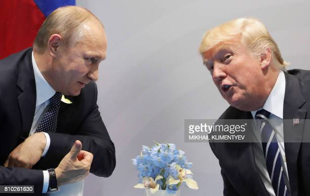 US President Donald Trump and Russia's President Vladimir Putin speaks during their meeting on the sidelines of the G20 Summit in Hamburg Germany on...