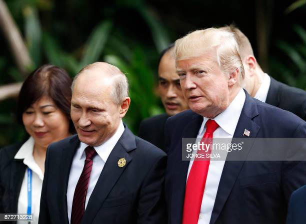 US President Donald Trump and Russia's President Vladimir Putin walk together to take part in the 'family photo' during the AsiaPacific Economic...
