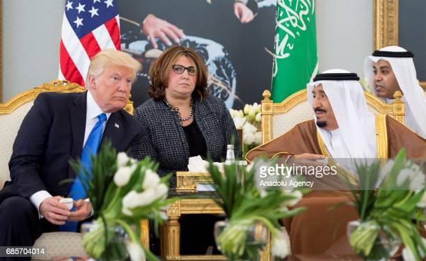US President Donald Trump and Saudi Arabia's King Salman bin Abdulaziz Al Saud are seen during their meeting with at the King Khalid International...