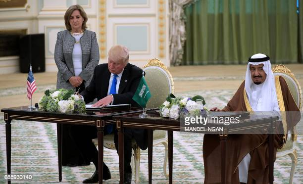 US President Donald Trump and Saudi Arabia's King Salman bin Abdulaziz alSaud take part in a signing ceremony at the Saudi Royal Court in Riyadh on...