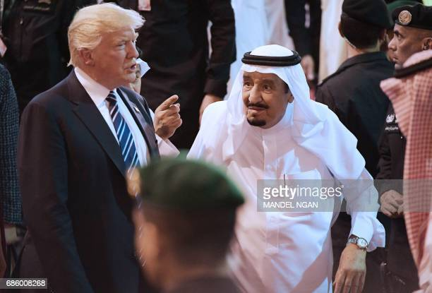 US President Donald Trump and Saudi Arabia's King Salman bin Abdulaziz alSaud take part in a welcome ceremony ahead of a banquet at Murabba Palace in...