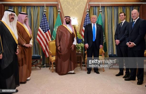 US President Donald Trump and Saudi Deputy Crown Prince Mohammad bin Salman alSaud take part in a bilateral meeting at a hotel in Riyadh on May 20...