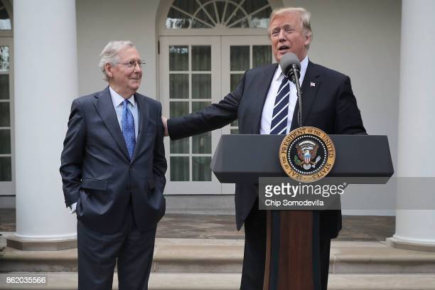 US President Donald Trump and Senate Majority Leader Mitch McConnell talk to reporters in the Rose Garden following a lunch meeting at the White...