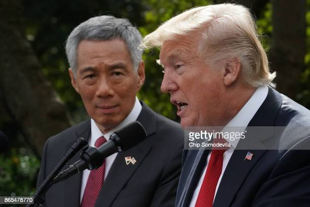 S President Donald Trump and Singapore Prime Minister Lee Hsien Loong deliver joint statements to the news media in the Rose Garden of the White...