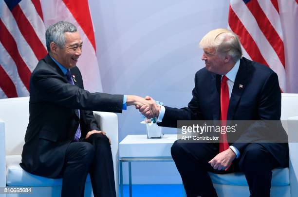 US President Donald Trump and Singapore's Prime Minister Lee Hsien Loong shake hands during a meeting on the sidelines of the G20 Summit in Hamburg...