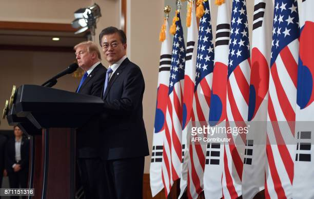 US President Donald Trump and South Korean President Moon JaeIn attend at a joint press conference at the presidential Blue House in Seoul on...