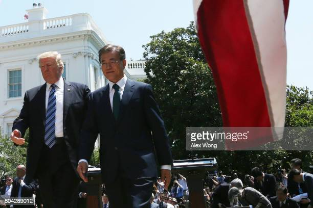 President Donald Trump and South Korean President Moon Jaein leave after they delivered joint statements in the Rose Garden of the White House on...